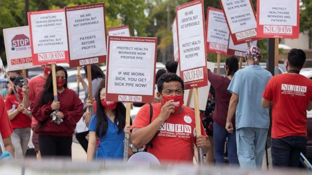 PHOTO: Workers at Kindred Hospital Westminster protest outside the hospital to demand better protection for them and their patients inside the 109-bed long-term care facility during the coronavirus outbreak in Westminster, Calif., July 22, 2020. (Mike Blake/Reuters)