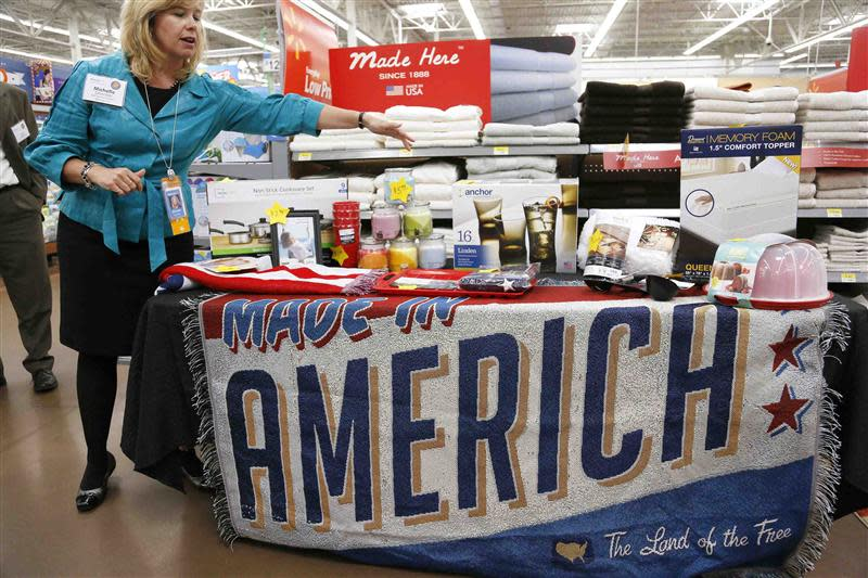 File photo of Gloeckler, senior vice-president of the home division at Wal-Mart Stores Inc, showing off a selection of merchandise made in the U.S. for sale at a Walmart Supercenter in Rogers
