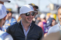 Entertainer Pitbull walks through pit road before a NASCAR Cup Series auto race at Charlotte Motor Speedway in Concord, N.C., Sunday, May 30, 2021. (AP Photo/Nell Redmond)