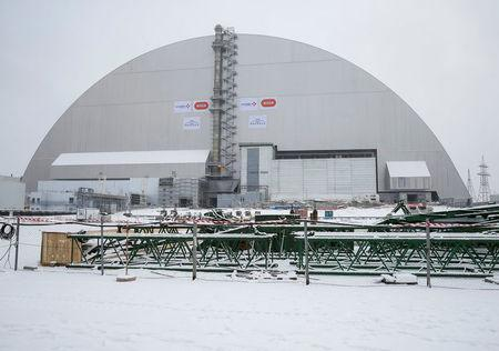 A general view shows a New Safe Confinement (NSC) structure over the old sarcophagus covering the damaged fourth reactor at the Chernobyl nuclear power plant, Ukraine, November 29, 2016. REUTERS/Gleb Garanich