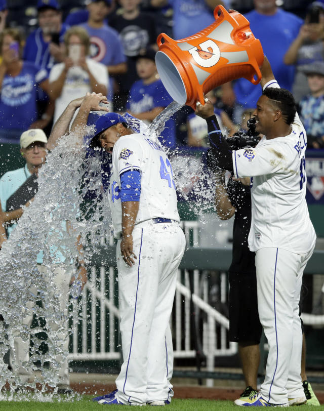 Kansas City Royals' Salvador Perez, right, douses teammates Brian Flynn, back, and Wily Peralta (43) following the team's baseball game against the Minnesota Twins at Kauffman Stadium in Kansas City, Mo., Saturday, July 21, 2018. The Royals defeated the Twins 4-2. (AP Photo/Orlin Wagner)
