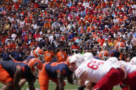 Fans return to Memorial Stadium during the first half of an NCAA college football game between Illinois and Nebraska Saturday, Aug. 28, 2021, in Champaign, Ill. Fans headed back into stadiums this weekend and, along with binoculars, sunscreen and other essentials, many will be packing face masks. (AP Photo/Charles Rex Arbogast)