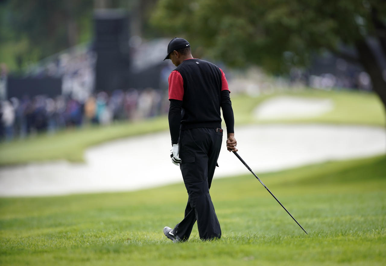 Tiger Woods reacts after hitting an errant second shot on the second hole during the final round of the Genesis Open golf tournament at Riviera Country Club on Sunday, Feb. 17, 2019, in the Pacific Palisades area of Los Angeles. (AP Photo/Ryan Kang)