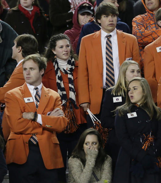 Auburn fans react near the end of a 49-0 loss to Alabama in a NCAA college football game at Bryant-Denny Stadium in Tuscaloosa, Ala., Saturday, Nov. 24, 2012. (AP Photo/Dave Martin)
