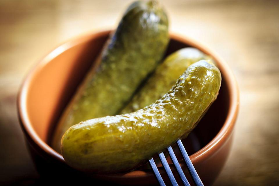 """<p>By which we mean preserved cucumbers, usually flavoured with dill and spices. But not all are created equal. Look for lacto-fermented varieties, not """"dead"""" vinegar pickles, which are the sterilised kind. Or make your own. """"They're easier to digest and contain lots of <a href=""""https://www.menshealth.com/uk/nutrition/a759066/the-benefits-of-vitamin-b/"""" rel=""""nofollow noopener"""" target=""""_blank"""" data-ylk=""""slk:vitamins"""" class=""""link rapid-noclick-resp"""">vitamins</a>, minerals and antioxidants,"""" says Anyia. """"Fermented foods boost immunity, too."""" Try in tuna salads or Cuban sandwiches.</p>"""