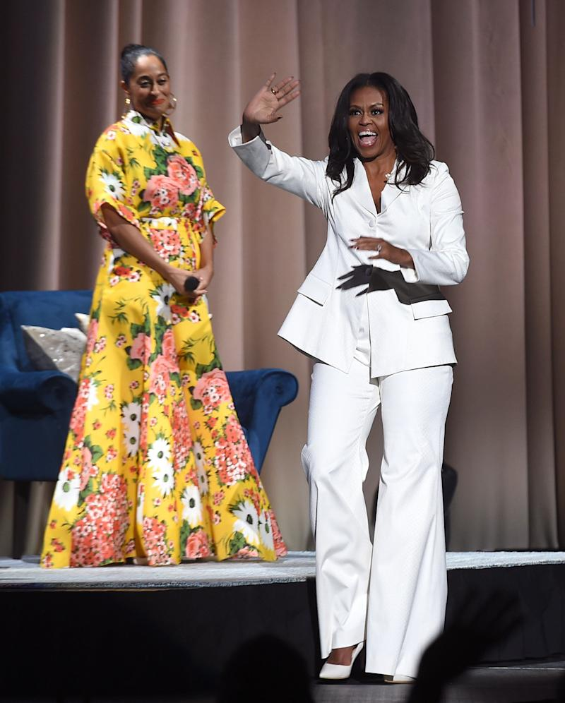 The author appears onstage with Tracee Ellis Ross at Becoming: An Intimate Conversation with Michelle Obama at the Forum on Nov. 15 in Inglewood, California.
