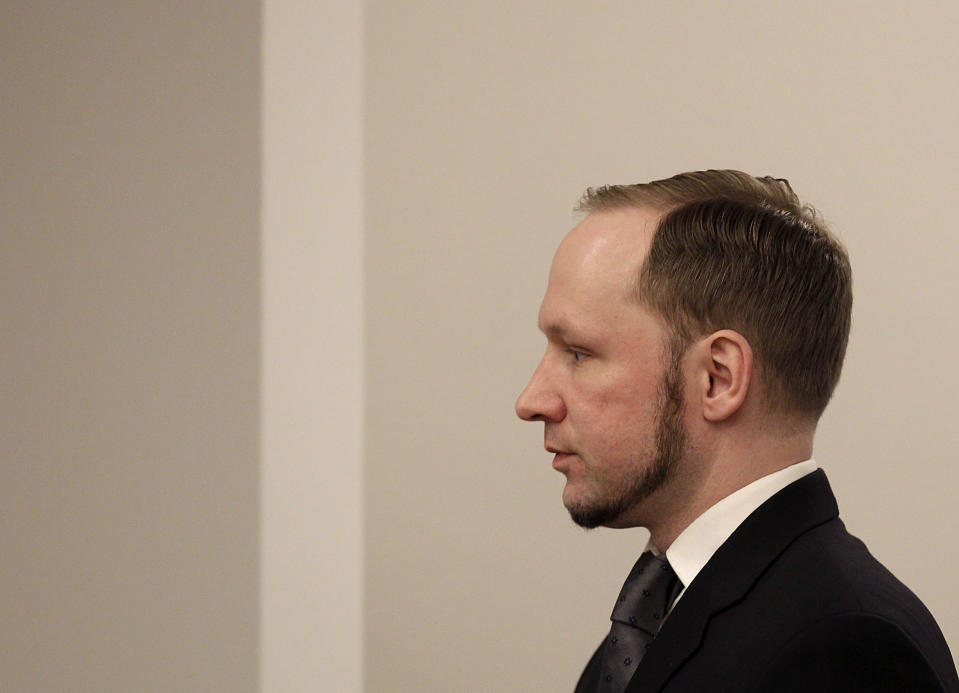 FILE - In this Friday, Aug. 24, 2012 file photo, confessed mass killer Anders Behring Breivik leaves the courtroom after the trial, in Oslo, Norway. On the ten-year anniversary of Norway's worst peacetime slaughter, survivors of Anders Breivik's 22 July assault worry that the seam of racism that nurtured the anti-Islamic mass-murderer is re-emerging. Most of Breivik's 77 victims were teen members of the Labor Party Youth wing - idealists enjoying their annual camping trip on the tranquil, wooded island of Utoya. Today many survivors are battling to keep their vision for their country alive. (AP Photo/Frank Augstein, File)