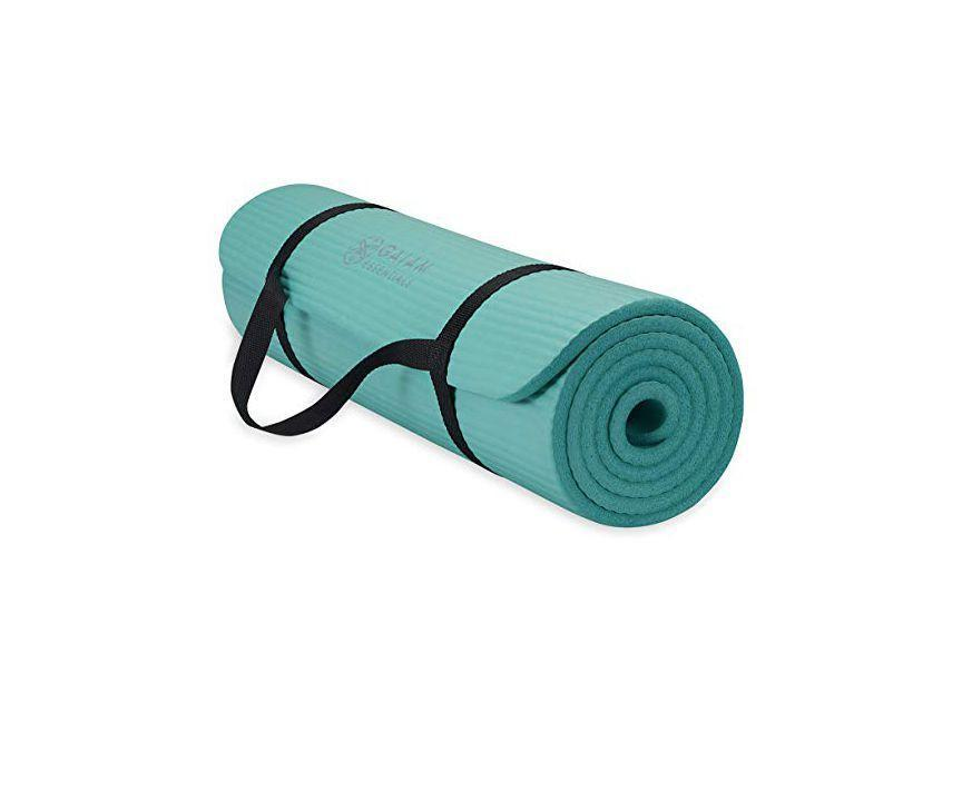 """<p><strong>Gaiam</strong></p><p>amazon.com</p><p><strong>$27.34</strong></p><p><a href=""""https://www.amazon.com/dp/B07H9PZ42P?tag=syn-yahoo-20&ascsubtag=%5Bartid%7C2141.g.23308279%5Bsrc%7Cyahoo-us"""" rel=""""nofollow noopener"""" target=""""_blank"""" data-ylk=""""slk:Shop Now"""" class=""""link rapid-noclick-resp"""">Shop Now</a></p><p>For the yogi within, Mom will love this Gaiam essential yoga mat. They're extra thick for a super comfortable floor workout and come in nine vibrant colors to show off a little personality. </p>"""