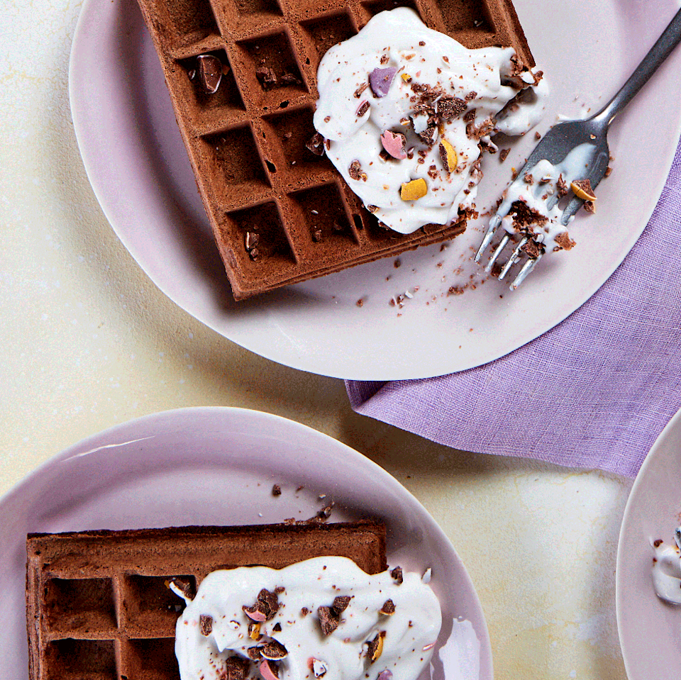 """<p>Upgrade your waffles to these chocolate waffles topped with mini eggs. </p><p>Get the <a href=""""https://www.delish.com/uk/cooking/recipes/a35679325/mini-egg-waffles/"""" rel=""""nofollow noopener"""" target=""""_blank"""" data-ylk=""""slk:Mini Egg Waffles"""" class=""""link rapid-noclick-resp"""">Mini Egg Waffles</a> recipe.</p>"""