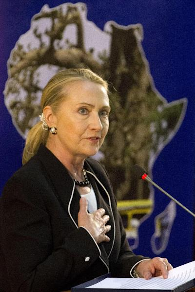 Secretary of State Hillary Rodham Clinton stands in front of an images in the shape of Africa as she speaks at the University of Cheikh Anta Diop in Dakar, Senegal, Wednesday, Aug. 1, 2012. (AP Photo/Jacquelyn Martin, Pool)
