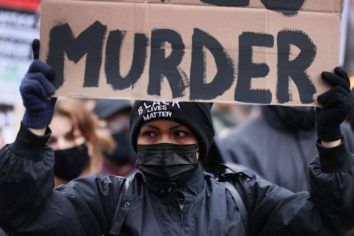 Demonstrators protest near the Hennepin County Courthouse in Minneapolis on April 19, 2021, as the jury deliberated in the trial of former police officer Derek Chauvin. The jury eventually convicted Chauvin of murdering George Floyd. (Photo: Scott Olson via Getty Images)