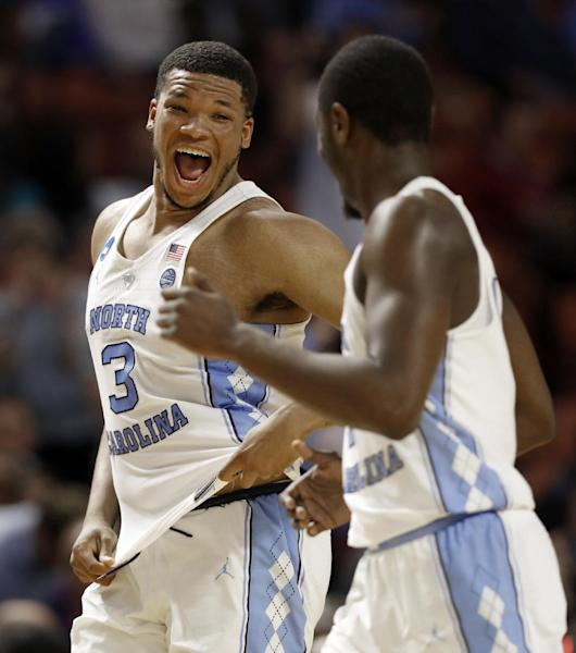 North Carolina's Kennedy Meeks (3) celebrates with Theo Pinson (1) as they leave the court at the end of the first half against Texas Southern in a first-round game of the NCAA men's college basketball tournament in Greenville, S.C., Friday, March 17, 2017. (AP Photo/Chuck Burton)