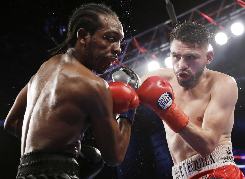 Jose Ramirez (R) punches Amir Imam during the ninth round of a WBC super lightweight championship boxing match Saturday, March 17, 2018, in New York. (AP Photo)