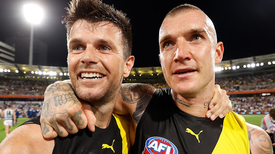 Richmond's Trent Cotchin and Dustin Martin are pictured celebrating together after the 2020 AFL grand final.