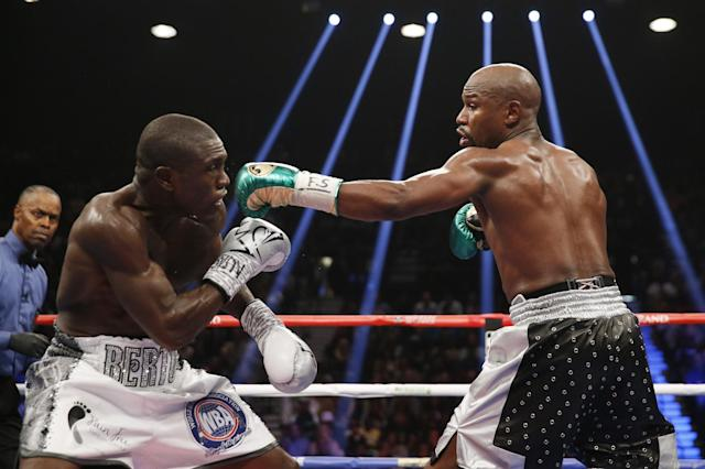 Andre Berto, left, lost a decision to Floyd Mayweather in September 2015. (AP)
