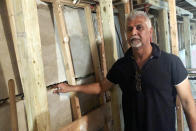 Sahadeo Bhagwandin shows a wide crack in the wall of his basement, in the Queens borough of New York, Friday, Sept. 17, 2021. Floodwaters surrounded his home after remnants of Hurricane Ida swept through the northeast, turning streets into torrent streams. It will takes tens of thousands of dollars to fix the buckled foundation. Without flood insurance, he is now trying to figure out how he will pay for expensive repairs. (AP Photo/Bobby Caina Calvan)