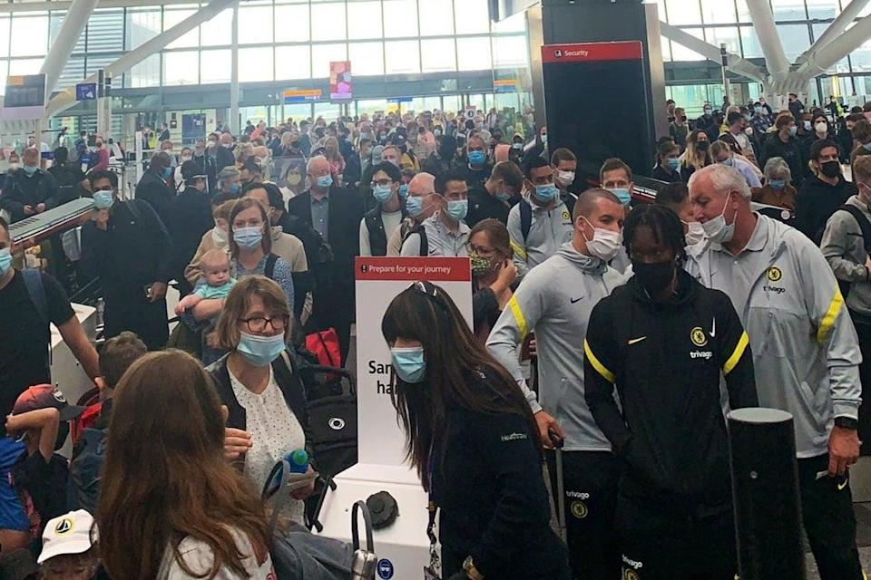 Queues at Heathrow earlier this month (PA)