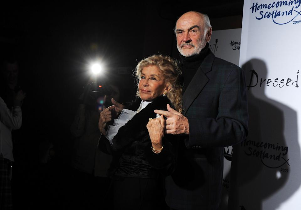 """Sir Sean Connery and wife Lady Micheline arrive at the 7th Annual """"Dressed To Kilt"""" charity fashion show to kick off Tartan Week on Monday, March 30, 2009 in New York. (AP Photo/Evan Agostini)"""