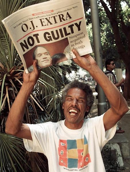 FILE - In this Oct. 3, 1995, file photo, Robert Graham holds the latest edition of the Pasadena, Calif., Star-News announcing O.J. Simpson being found not guilty of two murders, outside the Criminal Courts Building in Los Angeles. The return of O.J. Simpson to a Las Vegas courtroom next Monday, May, 13, will remind Americans of a tragedy that became a national obsession and in the process changed the country's attitude toward the justice system, the media and celebrity. (AP Photo/Eric Draper, File)