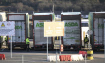 Police conduct a security sweep of lorries at the P&O ferry terminal in the port at Larne on the north coast of Northern Ireland, Friday, Jan. 1, 2021. This New Year's Day is the first day after Britain's Brexit split with the European bloc's vast single market for people, goods and services, and the split is predicted to impact the Northern Ireland border. (AP Photo/Peter Morrison)