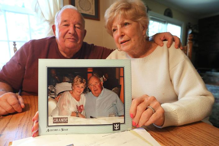 """Bertram """"Buzz"""" and Carol Palk of Whipanny talk about their difficult experiences after they were removed from a cruise ship in Mexico due to a problem with Carol's health. They are at their kitchen table on January 25, 2019 with a photo that was taken on the cruise ship before they were let go in Mexico."""