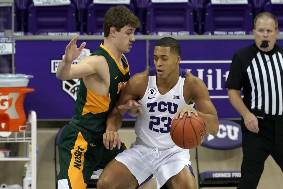 North Dakota State forward Rocky Kreuser (34) defends as TCU forward Jaedon LeDee (23) works for a shot opportunity in the first half of an NCAA college basketball game in Fort Worth, Texas, Tuesday, Dec. 22, 2020. (AP Photo/Tony Gutierrez)