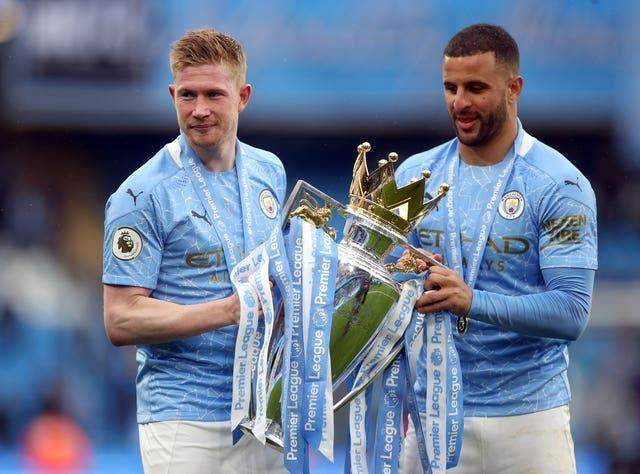 Kyle Walker, right, played a role in Manchester City's Premier League title win