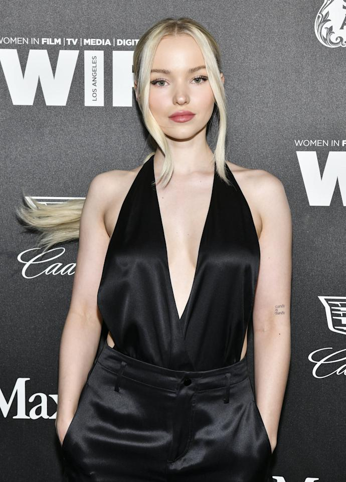"<p>Cameron opened up about her father passing away when she was 15 and <a href=""https://www.refinery29.com/en-us/2019/11/8705156/dove-cameron-tattoo-meanings"" target=""_blank"" class=""ga-track"" data-ga-category=""Related"" data-ga-label=""https://www.refinery29.com/en-us/2019/11/8705156/dove-cameron-tattoo-meanings"" data-ga-action=""In-Line Links"">said that the phrase ""candy is dandy""</a> is her first tattoo in memory of him. It's located on her inner elbow of her left arm.</p>"