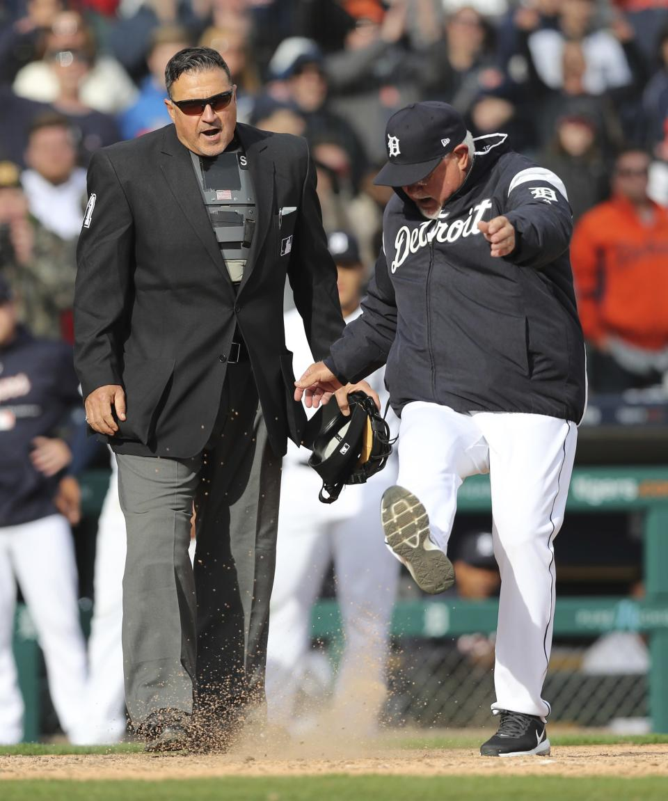 Detroit Tigers manager Ron Gardenhire, right, kicks dirt onto home plate next to umpire Tony Randazzo after a play was overturned during the tenth inning of a baseball game against the Pittsburgh Pirates, Friday, March 30, 2018, in Detroit. Gardenhire was ejected by Randazzo. (AP Photo/Carlos Osorio)