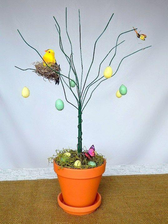 """<p>All you need is a terra cotta planter, stem wire, and floral foam to make this sweet and simple tree. Buy readymade ornaments or make your own—you can't go wrong! </p><p><strong>Get the tutorial at <a href=""""http://www.tattooedmartha.com/2013/03/26/diy-easter-tree/"""" rel=""""nofollow noopener"""" target=""""_blank"""" data-ylk=""""slk:Tattooed Martha"""" class=""""link rapid-noclick-resp"""">Tattooed Martha</a>.</strong></p><p><a class=""""link rapid-noclick-resp"""" href=""""https://www.amazon.com/Plastic-Sparkling-Easter-Ornaments-Decorations/dp/B0793KQDNS/ref=sr_1_4?tag=syn-yahoo-20&ascsubtag=%5Bartid%7C10050.g.26498744%5Bsrc%7Cyahoo-us"""" rel=""""nofollow noopener"""" target=""""_blank"""" data-ylk=""""slk:SHOP EGG ORNAMENTS"""">SHOP EGG ORNAMENTS</a></p>"""