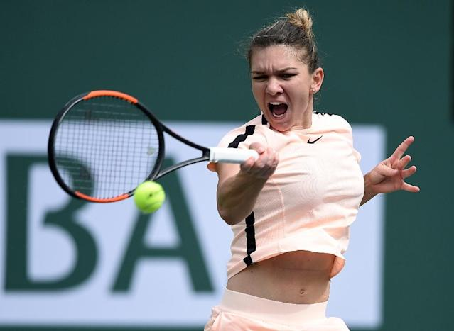 Simona Halep of Romania hits a forehand against Qiang Wang of China on March 13, 2018 in Indian Wells, California (AFP Photo/KEVORK DJANSEZIAN)