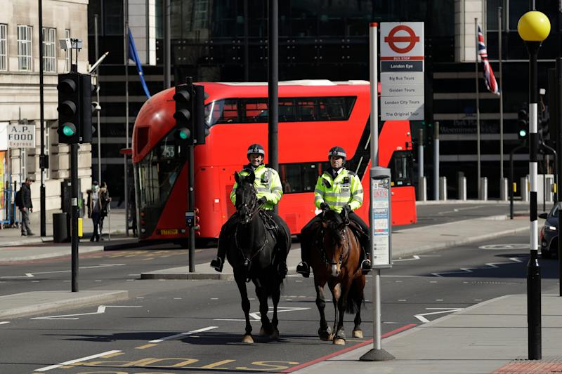 Two mounted police make their way over Westminster Bridge in London (Photo: ASSOCIATED PRESS)