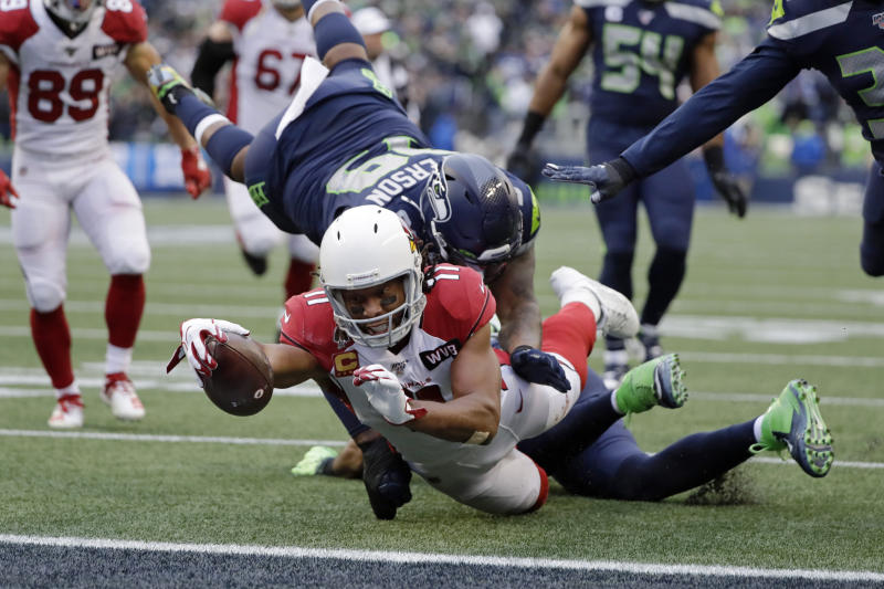 Arizona Cardinals wide receiver Larry Fitzgerald (11) scores a touchdown against the Seahawks. (AP Photo/Elaine Thompson)