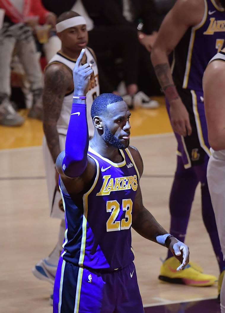 Los Angeles Lakers forward LeBron James gestures after scoring during the first half of the team's NBA basketball game against the Denver Nuggets on Wednesday, March 6, 2019, in Los Angeles. With the basket, James passed Michael Jordan for fourth place on the NBA's career scoring list.