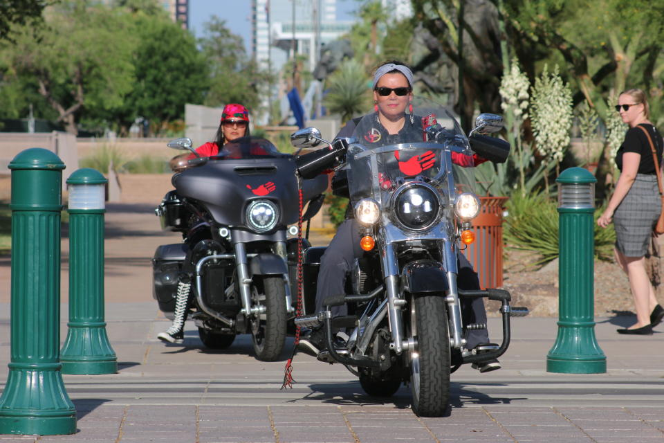 Shelly Denny, front, was among the riders from Medicine Wheel Ride who rode their bikes to the Arizona State Capitol in Phoenix, Wednesday, May 5, 2021, to raise awareness for missing and murdered Indigenous women and girls. (AP Photo/Cheyanne Mumphrey)