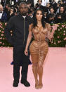 """FILE - Kanye West, left, and Kim Kardashian attend The Metropolitan Museum of Art's Costume Institute benefit gala celebrating the opening of the """"Camp: Notes on Fashion"""" exhibition on May 6, 2019, in New York. Kim Kardashian West filed for divorce Friday, Feb. 19, 2021, from Kanye West after 6 1/2 years of marriage. Sources familiar with the filing but not authorized to speak publicly confirmed that Kardashian filed for divorce in Los Angeles Superior Court. The filing was not immediately available. (Photo by Charles Sykes/Invision/AP, File)"""