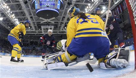 Sweden's goalie Valentina Wallner is beaten by a shot from Team USA's Monique Lamoureux (not shown) during the second period of their women's semi-final ice hockey game at the Sochi 2014 Winter Olympic Games, February 17, 2014. REUTERS/Bruce Bennett/Pool
