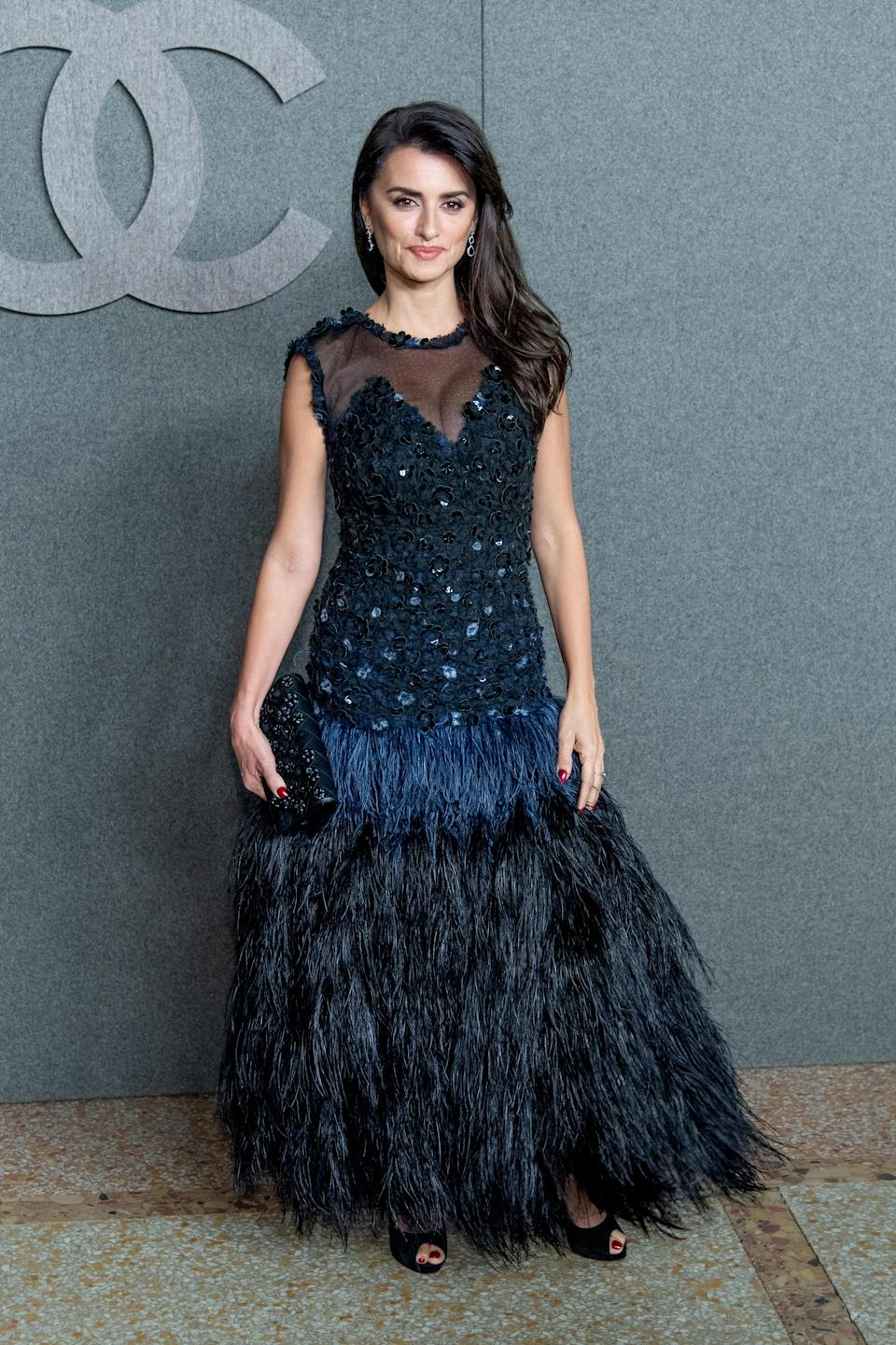 <p>Clad in a drop-waisted, feather-embellished dress, the Spanish star certainly had the wow-factor at the fashion event. <em>[Photo: Getty]</em> </p>
