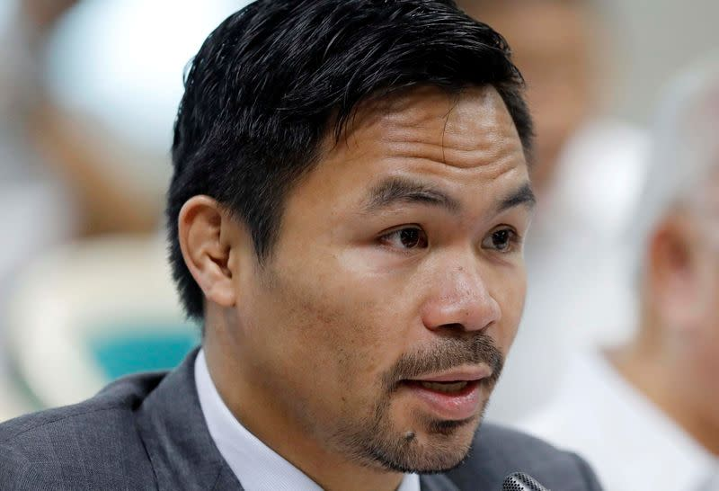 FILE PHOTO: Philippine Senator and boxer Manny Pacquiao speaks during the Congressional confirmation hearing of Environment Secretary Regina Lopez at the Senate in Manila