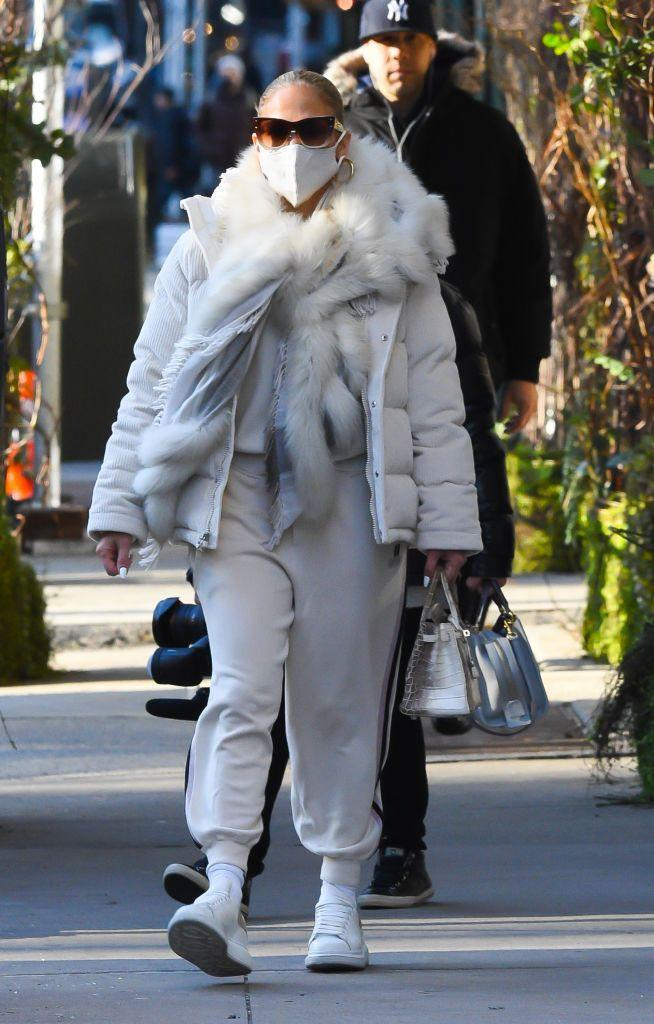 <p>The singer and actress seems to have adopted a 'no days off' approach to December style as she steps out in yet another inspired ensemble. </p><p>Jennifer Lopez wore an all-white tracksuit and puffer jacket pairing accompanied of course by a matching mask and tortoise-hued shades. </p><p>Lopez dipped into her envy worthy bag collection for a Hermès Himalayan crocodile Birkin and topped off the glacial look with a furry scarf, to top off the outfit. </p>