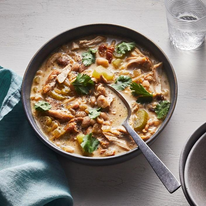 """<p>This rich, yet healthy, white chicken chili comes together in a flash thanks to quick-cooking chicken thighs and canned white beans. Mashing some of the beans acts as a fast thickener when your soups don't have a long time to simmer. Cream cheese adds the final bit of richness and a hint of sweet tang. <a href=""""https://www.eatingwell.com/recipe/269831/creamy-white-chili-with-cream-cheese/"""" rel=""""nofollow noopener"""" target=""""_blank"""" data-ylk=""""slk:View Recipe"""" class=""""link rapid-noclick-resp"""">View Recipe</a></p>"""
