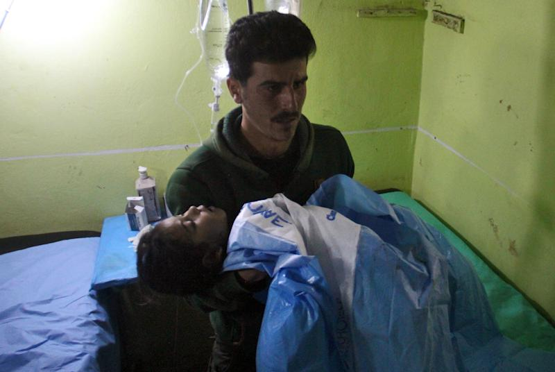 An unconscious Syrian child awaits treatment at a hospital in Khan Sheikhun, a rebel-held town in the northwestern Syrian Idlib province, following the chemical attack last week: Getty