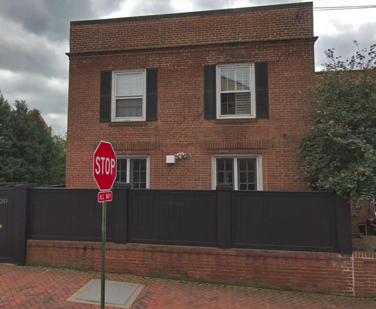 """The unassuming brick home was used as the exterior of Regan MacNeil's home in """"The Exorcist."""" (Photo courtesy of Zillow)"""