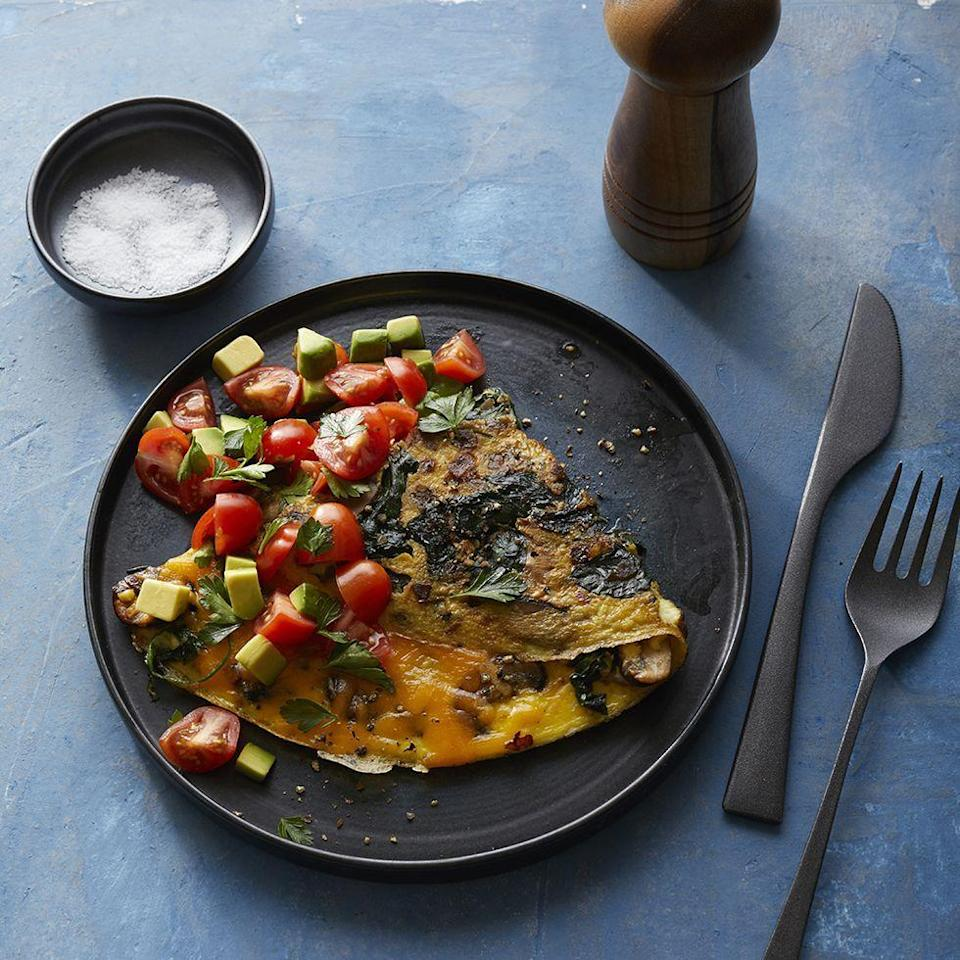"""<p>Who doesn't love an omelette? This one is a perfect mix of healthy ingredients, but its main draw is being absolutely packed with protein and fiber, meaning a day with zero cravings.</p><p><a href=""""https://www.prevention.com/food-nutrition/recipes/a28090275/cheesy-avocado-omelette-recipe/"""" rel=""""nofollow noopener"""" target=""""_blank"""" data-ylk=""""slk:Get the recipe from Prevention »"""" class=""""link rapid-noclick-resp""""><strong><em>Get the recipe from Prevention »</em></strong> </a></p>"""