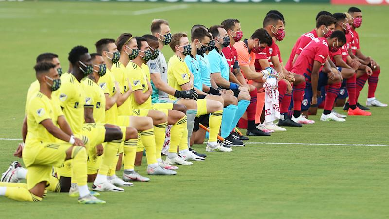 Players from FC Dallas and Nashville SC, pictured here taking a knee before their MLS clash.
