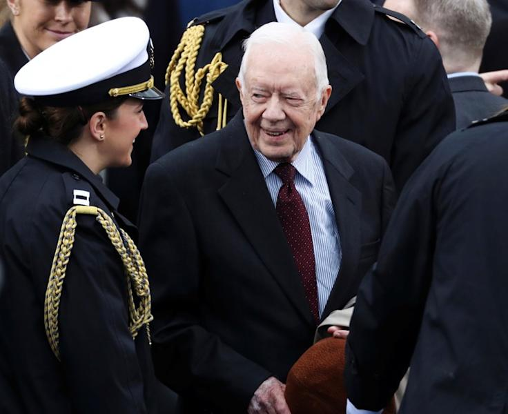 FILE PHOTO: Former president Jimmy Carter arrives at inauguration ceremonies swearing in Donald Trump as the 45th president of the United States on the West front of the U.S. Capitol in Washington