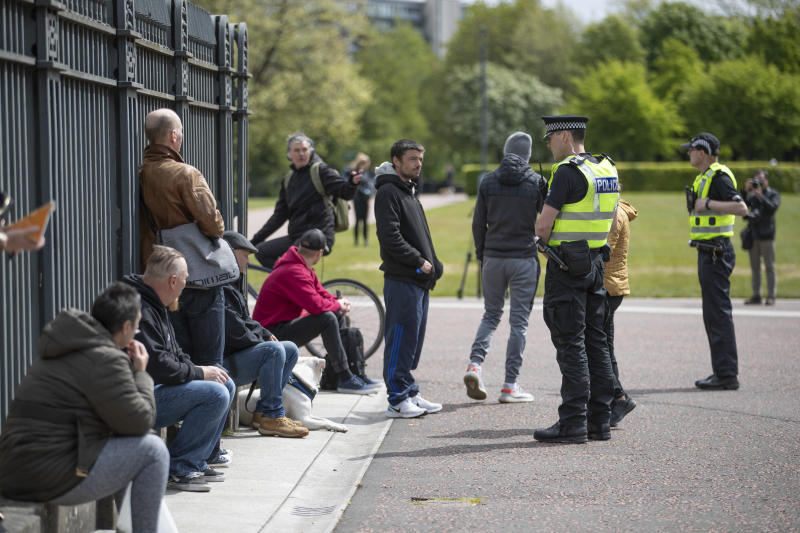 Police patrol Glasgow Green where members of the public gathered, as part of gatherings taking place this weekend across the UK against the coronavirus pandemic restrictions after the introduction of measures to bring the country out of lockdown.