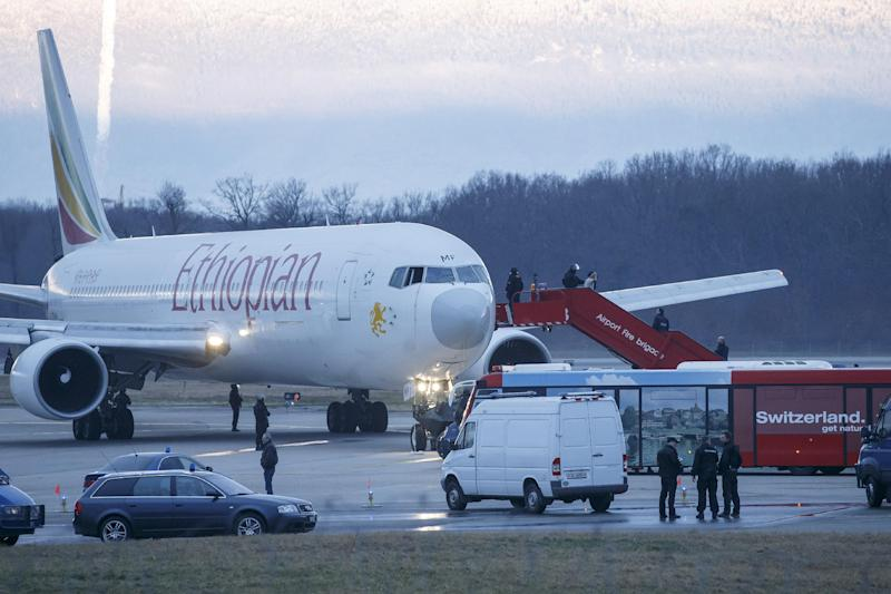 Passengers are evacuated from a hijacked Ethiopian Airlines Plane on the airport in Geneva, Switzerland, Monday, Feb. 17, 2014. A hijacked aircraft traveling from Addis Abeda, Ethiopia, to Rome, Italy, has landed at Geneva's international airport early Monday morning. Swiss authorities have arrested the hijacker. (AP Photo/Keystone, Salvatore Di Nolfi)