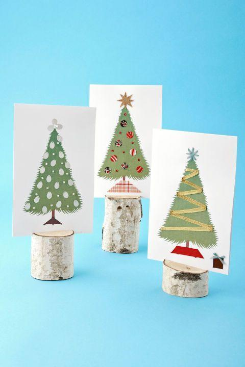 """<p>A sweet alternative to store-bought cards, these greetings put your tree-decorating skills to work — on a small scale. </p><p>Send a bright red greeting from Rudolf, everyone's favorite spreader of holiday cheer.<br> <strong><br>To make:</strong> <a href=""""https://www.countryliving.com/diy-crafts/how-to/a3266/christmas-craft-templates/"""" rel=""""nofollow noopener"""" target=""""_blank"""" data-ylk=""""slk:Download our illustration"""" class=""""link rapid-noclick-resp"""">Download our illustration</a>, and print in color onto 8 1/2- by 11-inch card stock. Fold the stock in half lengthwise, creasing with a bone folder.</p><p>For the card at top left, attach small bugle beads and paillettes to the tree (use craft glue for all designs).</p><p>To replicate the middle version, cut out ornaments (made by tracing a button), a tree base, and a star from patterned fabrics and adhere.</p><p>Make the last card by zigzagging a length of ribbon across the tree. Fold the ends under and glue, then try other widths of ribbon to craft a base, star, and gift. Or use your imagination, and whatever supplies you have on hand, to make your own one-of-a-kind cards.</p><p><a class=""""link rapid-noclick-resp"""" href=""""https://www.amazon.com/Darice-GX-2200-18-20-Piece-Stock-12-Inch/dp/B0086XIDH0/?tag=syn-yahoo-20&ascsubtag=%5Bartid%7C10050.g.3872%5Bsrc%7Cyahoo-us"""" rel=""""nofollow noopener"""" target=""""_blank"""" data-ylk=""""slk:SHOP WHITE CARDSTOCK PAPER"""">SHOP WHITE CARDSTOCK PAPER</a><br></p>"""