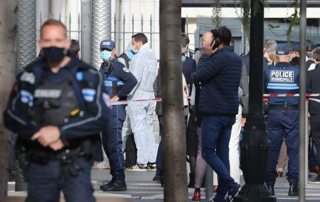 French forensics officers arrive at the site of a knife attack in Nice on October 29, 2020.